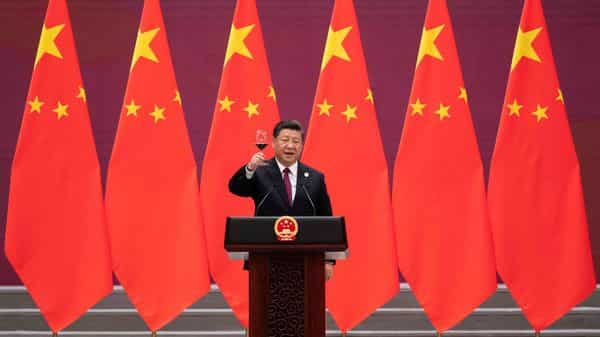 China's President Xi Jinping raises his glass and proposes a toast at the end of his speech during the welcome banquet for leaders attending the Belt and Road Forum at the Great Hall of the People in Beijing